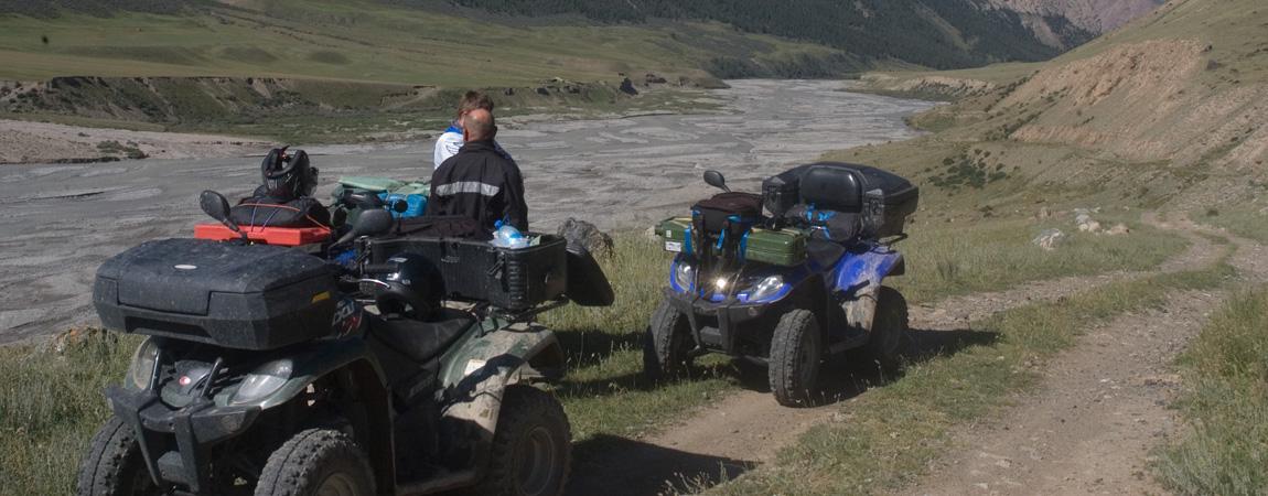 Quad off road adventure tour through the high mountain range of the Tian Shan
